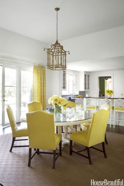 a cheery yellow and white kitchen serves as a palate cleanser off the dining room paterson says chairs and stools are covered in piton vinyl from