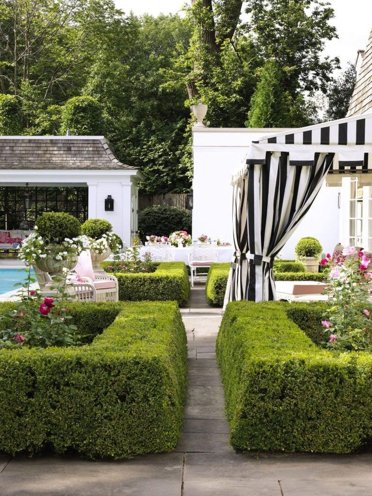 custom-awning-black-white-stripes-hollywood-regency-rose-garden-boxwoods-roses